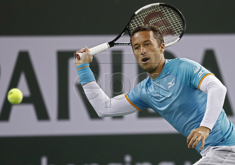 Philipp Kohlschreiber of Germany in action against Novak Djokovic of Serbia during the BNP Paribas Open tennis tournament at the Indian Wells Tennis Garden in Indian Wells, California, USA, 11 March 2019. The men's and women's final will be played, 17 March 2019. EPA-EFE/LARRY W. SMITH