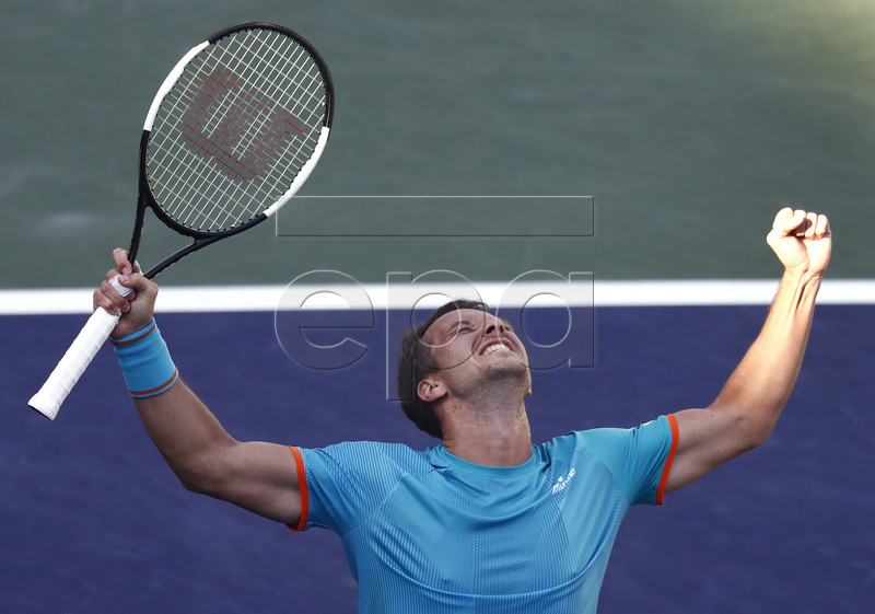 Philipp Kohlschreiber of Germany reacts after beating Novak Djokovic of Serbia in two sets during the BNP Paribas Open tennis tournament at the Indian Wells Tennis Garden in Indian Wells, California, USA, 12 March 2019. The men's and women's final will be played, 17 March 2019. EPA-EFE/LARRY W. SMITH