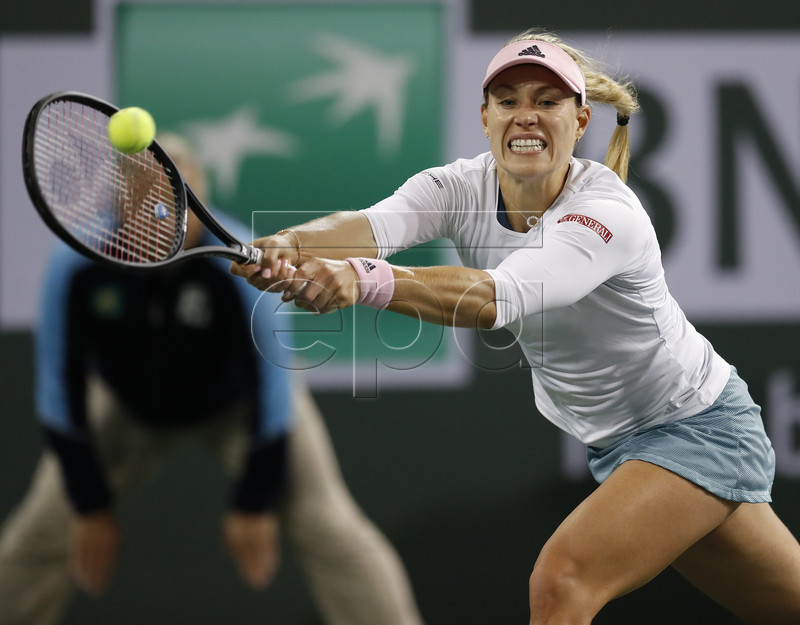 Angelique Kerber of Germany in action against Belinda Bencic of Switzerland during the BNP Paribas Open tennis tournament at the Indian Wells Tennis Garden in Indian Wells, California, USA, 15 March 2019. EPA-EFE/JOHN G. MABANGLO