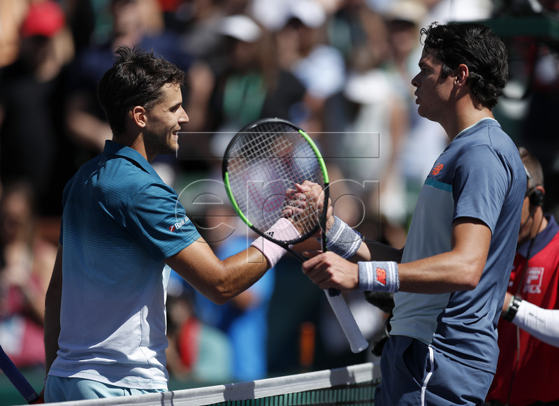 Dominic Thiem of Austria (L) shakes hands with Milos Raonic of Canada in their semifinal match during the BNP Paribas Open tennis tournament at the Indian Wells Tennis Garden in Indian Wells, California, USA, 16 March 2019. The men's and women's final will be played, 17 March 2019. EPA-EFE/JOHN G. MABANGLO