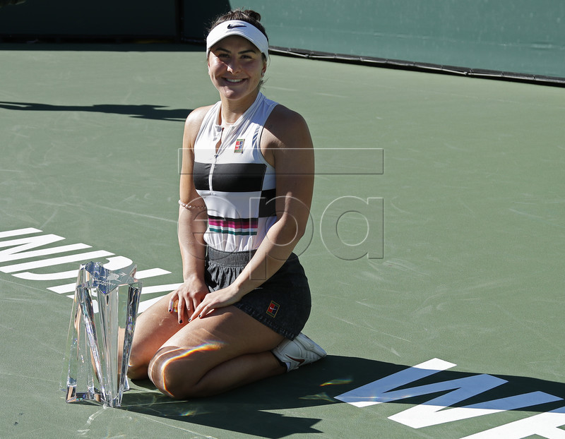 Bianca Andreescu of Canada poses with the trophy after winning against Angelique Kerber of Germany during the Finals at the BNP Paribas Open tennis tournament at the Indian Wells Tennis Garden in Indian Wells, California, USA, 17 March 2019. EPA-EFE/JOHN G MABANGLO