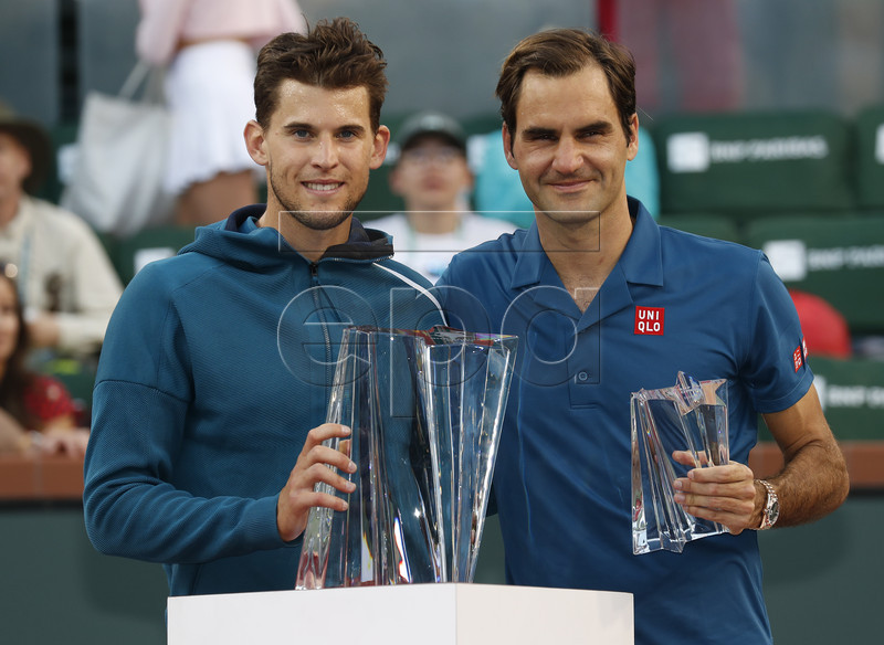 Dominic Thiem (L) of Austria and Roger Federer (R) of Switzerland pose with their trophies during the BNP Paribas Open tennis tournament at the Indian Wells Tennis Garden in Indian Wells, California, USA, 17 March 2019. Thiem defeated Federer in the men's finals. EPA-EFE/JOHN G. MABANGLO