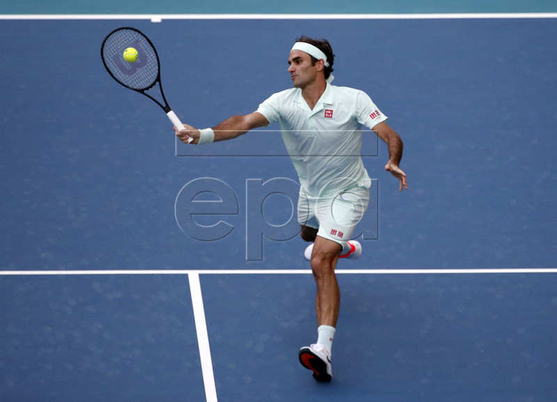 Roger Federer of Switzerland in action against Radu Albot of Moldova during their match at the Miami Open tennis tournament in Miami, Florida, USA, 23 March 2019. EPA-EFE/JASON SZENES