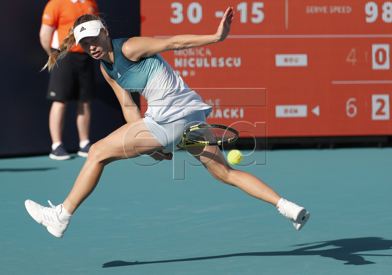 Caroline Wozniacki of Denmark in action against Monica Niculescu of Romania during their women's singles match at the Miami Open tennis tournament in Miami, Florida, USA, 23 March 2019. EPA-EFE/RHONA WISE