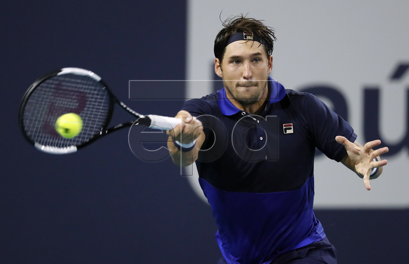 Dusan Lajovic of Serbia in action against Nick Kyrgios of Australia during their match at the Miami Open tennis tournament in Miami, Florida, USA, 24 March 2019. EPA-EFE/RHONA WISE