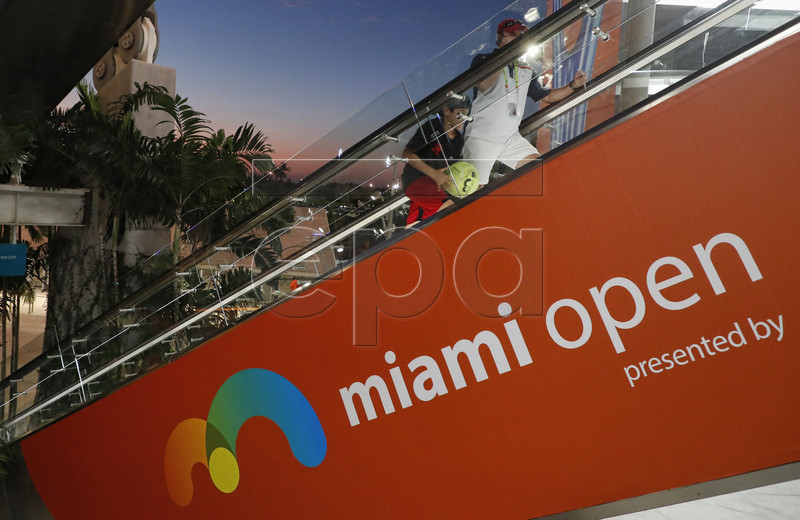 Fans take the escalator to the upper level of the stadium court at the Miami Open tennis tournament in Miami, Florida, USA, 24 March 2019. EPA-EFE/RHONA WISE