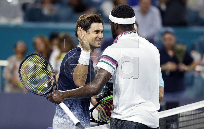 Frances Tiafoe of the USA (R) and David Ferrer of Spain (L) meet at the net following their men's singles match at the Miami Open tennis tournament in Miami, Florida, USA, 25 March 2019. EPA-EFE/RHONA WISE