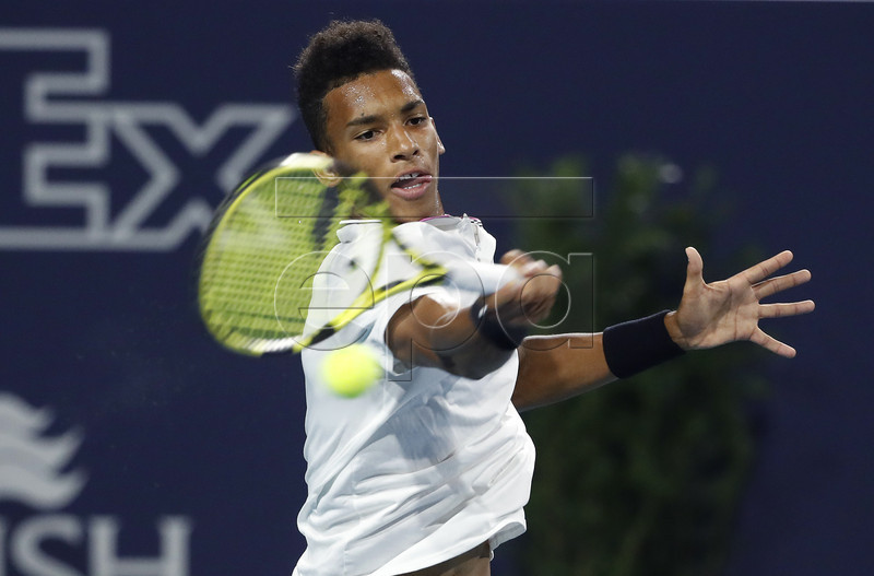 Felix Auger Aliassime of Canada in action against Borna Coric of Croatia during their men's singles match at the Miami Open tennis tournament in Miami, Florida, USA, 27 March 2019. EPA-EFE/RHONA WISE