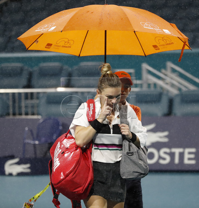 Simona Halep of Romania walks off the court during a rain delay in her match against Karolina Pliskova of the Czech Republic during their semifinals match at the Miami Open tennis tournament in Miami, Florida, USA, 28 March 2019. EPA-EFE/JASON SZENES