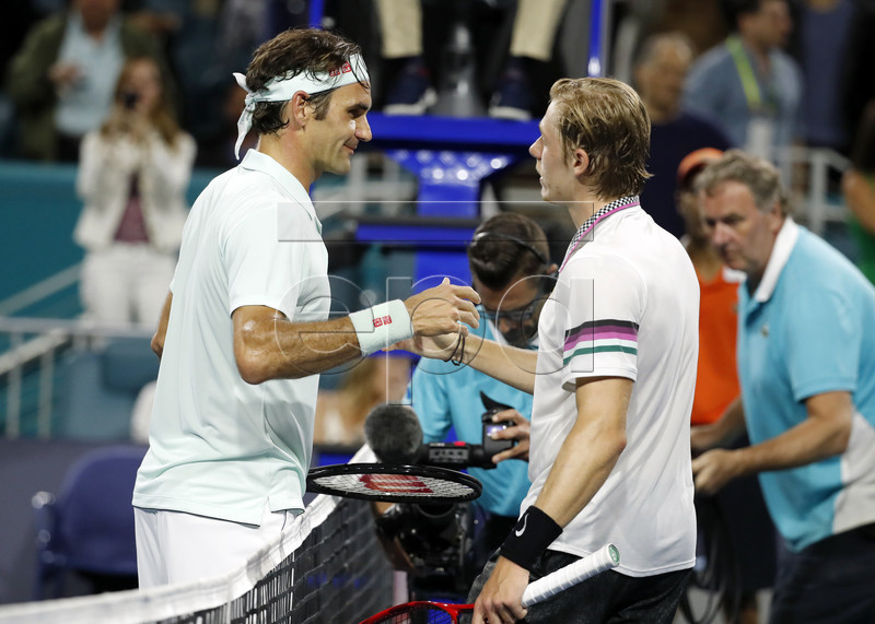Roger Federer of Switzerland (L) meets Denis Shapovalov of Canada (R) at the net following their semifinal match at the Miami Open tennis tournament in Miami, Florida, USA, 29 March 2019. EPA-EFE/RHONA WISE