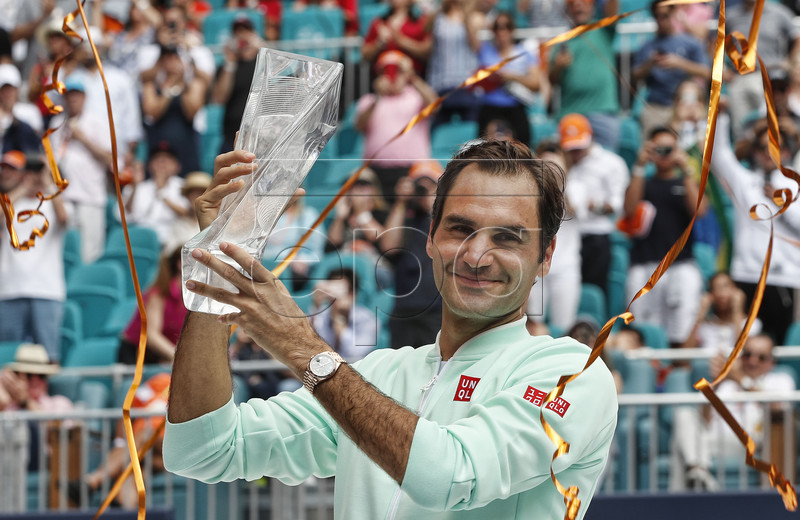 Roger Federer of Switzerland holds his trophy after defeating John Isner of the US following their Men's finals match at the Miami Open tennis tournament in Miami, Florida, USA, 31 March 2019. EPA-EFE/RHONA WISE