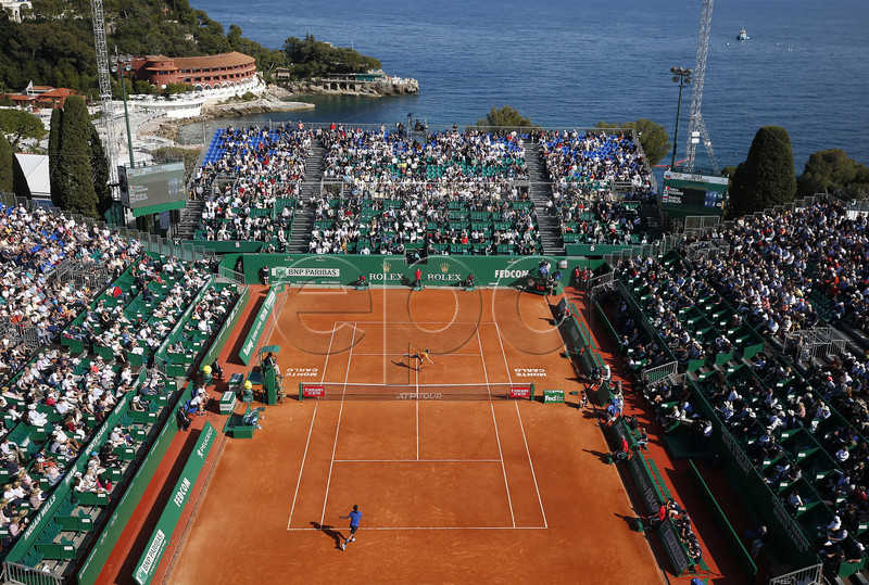 Fabio Fognini (down) of Italy in action during his first round match against Andrey Rublev (top) of Russia at the Monte-Carlo Rolex Masters tournament in Roquebrune Cap Martin, France, 15 April 2019. EPA-EFE/SEBASTIEN NOGIER