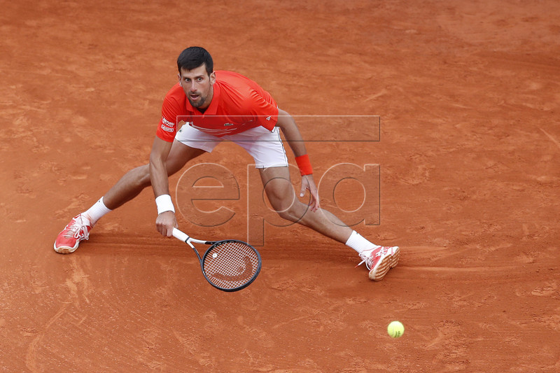 Novak Djokovic of Serbia in action during his second round match against Philipp Kohlschreiber of Germany at the Monte-Carlo Rolex Masters tournament in Roquebrune Cap Martin, France, 16 April 2019. EPA-EFE/SEBASTIEN NOGIER