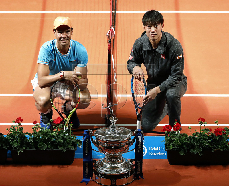 Spanish tennis player Rafael Nadal (L) and Kei Nishikori (R) of Japan pose during a press preview on occasion of the presentation of the 67th Barcelona Open Trofeo Conde de Godo tennis tournament at the Catalan Music Palace in Barcelona, Spain, 22 April 2019. The arcelona Open Trofeo Conde de Godo tennis tournament 2019 will be played in Barcelona from 20 until 28 April 2019. EPA-EFE/Andreu Dalmau