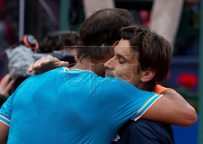 Spanish tennis player Rafa Nadal (L) embraces fellow countryman David Ferrer (R) after his victory in their third round men's single match of the 67th Barcelona Open Trofeo Conde de Godo tennis tournament, in Barcelona, Spain, 25 April 2019. EPA-EFE/Enric Fontcuberta