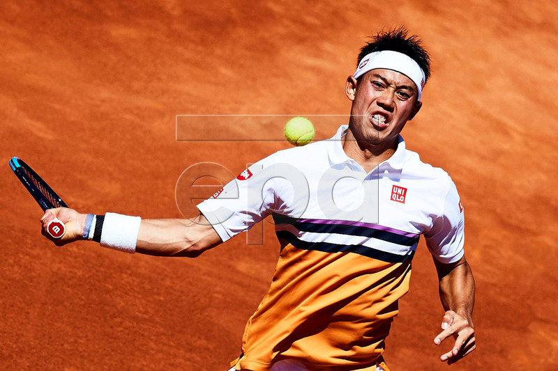 Kei Nishikori of Japan in action against Roberto Carballes Baena of Spain during their quarter final match of the 67th Barcelona Open Trofeo Conde de Godo tennis tournament in Barcelona, northeastern Spain, 26 April 2019. EPA-EFE/ALEJANDRO GARCIA