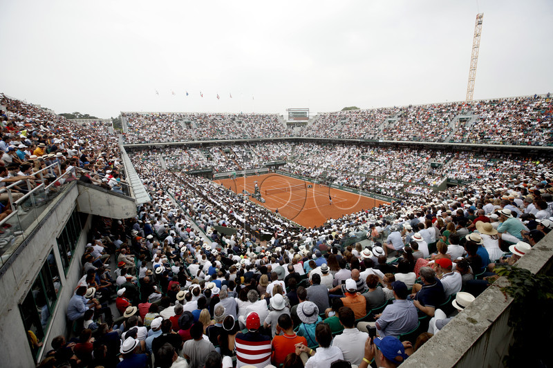 A general view of court Philippe Chatrier as Rafael Nadal of Spain plays Dominic Thiem of Austria (front) during their men?s final match during the French Open tennis tournament at Roland Garros in Paris, France, 10 June 2018. EPA-EFE/YOAN VALAT