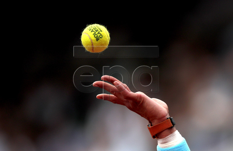 Rafael Nadal of Spain serves to Dominic Thiem of Austria during their men?s final match during the French Open tennis tournament at Roland Garros in Paris, France, 10 June 2018. EPA-EFE/YOAN VALAT