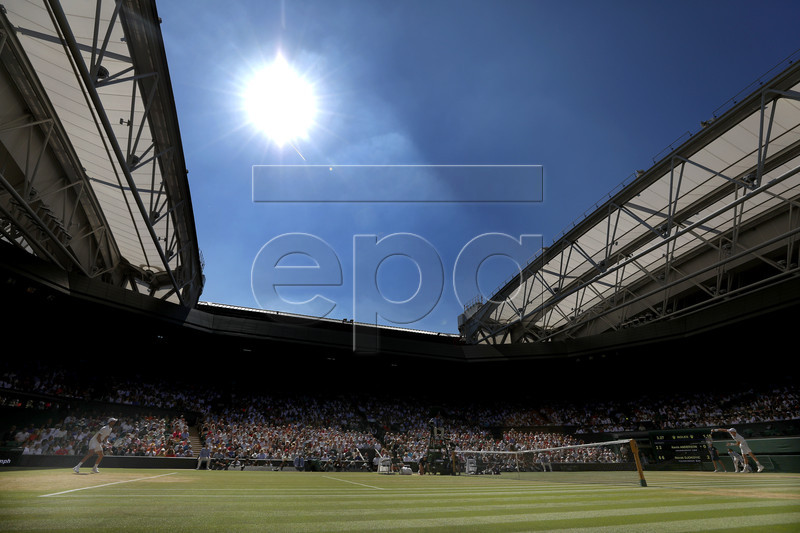 Novak Djokovic of Serbia (L) plays Kevin Anderson of South Africa (R) in the men's singles final of the Wimbledon Championships at the All England Lawn Tennis Club, in London, Britain, 15 July 2018. EPA-EFE/NIC BOTHMA EDITORIAL USE ONLY/NO COMMERCIAL SALES