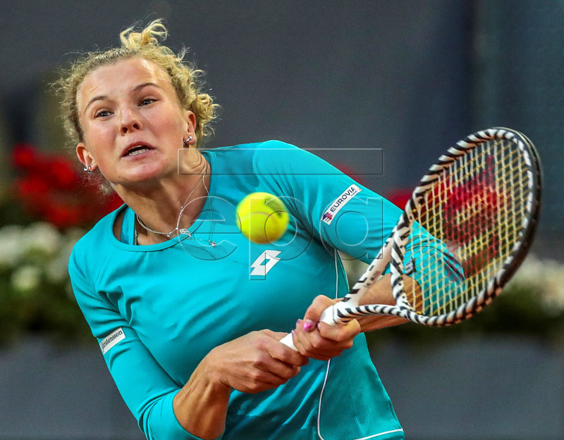Katerina Siniakova of the Czech Republic in action against Kiki Bertens of the Netherlands during their first round match of the Mutua Madrid Open 2019 tennis tournament at Caja Magica in Madrid, Spain, 04 May 2019. EPA-EFE/JUANJO MARTIN