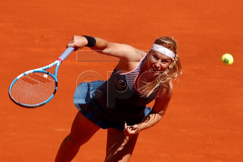 Slovak tennis player Dominika Cibulkova in action against Japanese Naomi Osaka during their Mutua Madrid Open's tournament round of 64 game at Caja Magica tennis complex, in Madrid, Spain, 05 May 2019. The tournament runs from 3 to 12 May 2019. EPA-EFE/CHEMA MOYA