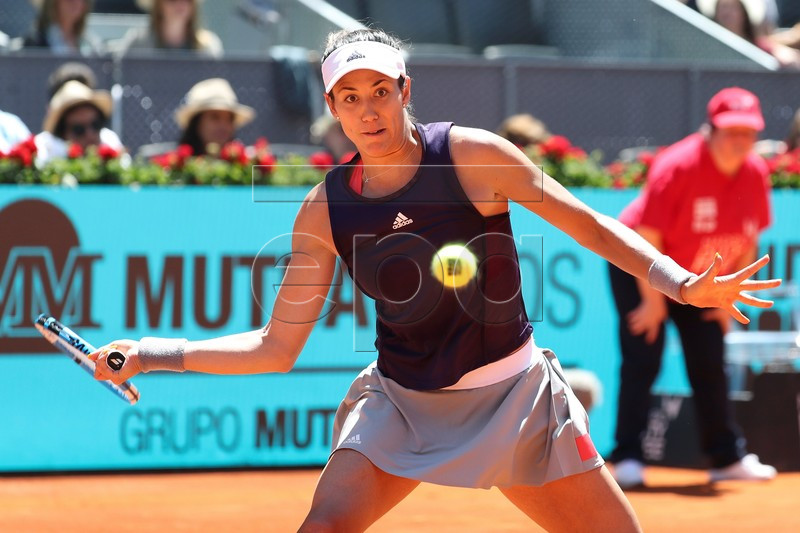 Garbine Muguruza of Spain in action during her first round match against Petra Martic of Croatia at the Mutua Madrid Open tennis tournament, in Madrid, Spain, 05 May 2019. EPA-EFE/KIKO HUESCA