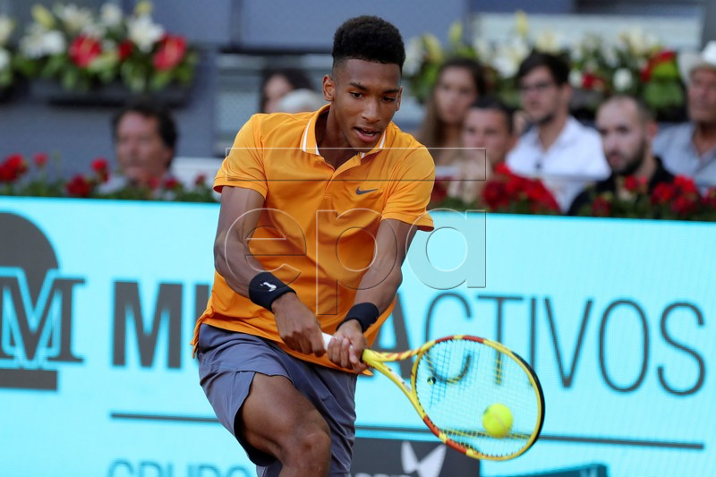 Felix Auger-Aliassime of Canada in action during his first round match against fellow countryman Denis Shapovalov at the Mutua Madrid Open tennis tournament, in Madrid, Spain, 05 May 2019. EPA-EFE/JUANJO MARTIN