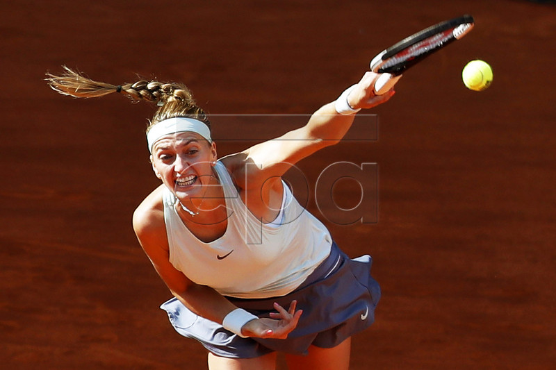 Petra Kvitova of the Czech Republic in action against Kristina Mladenovic of France during their second round match of the Mutua Madrid Open tennis tournament at the Caja Magica complex in Madrid, Spain, 06 May 2019. EPA-EFE/JAVIER LIZON