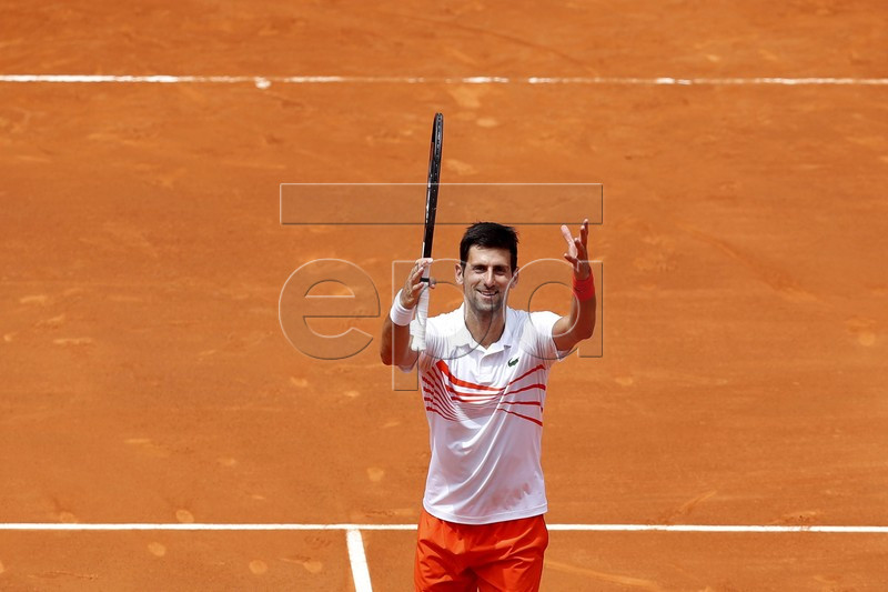 Serbian player Novak Djokovic celebrates winning his men's second round match against US player Taylor Fritz at the Mutua Madrid Open tennis tournament in Madrid, Spain, 07 May 2019. EPA-EFE/JAVIER LIZON