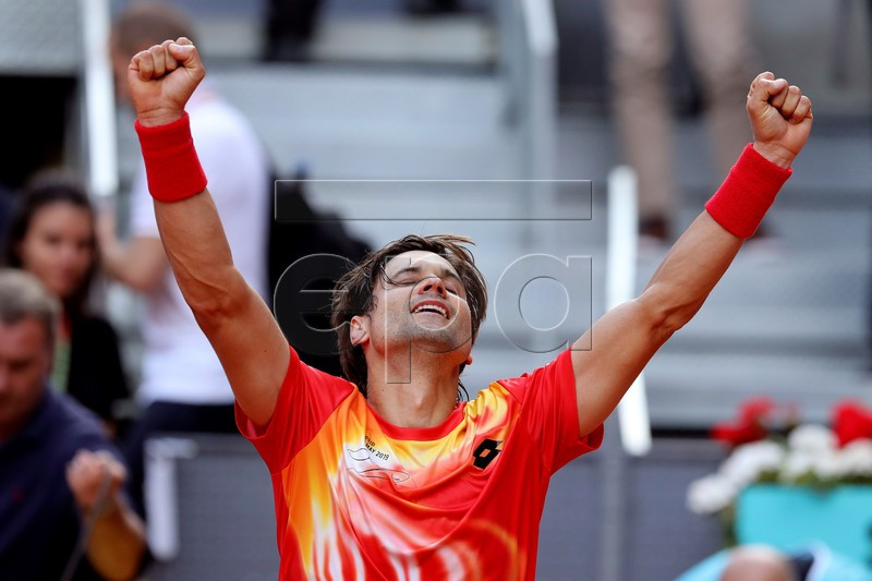 Spain's David Ferrer celebrates winning his first round match against compatriot Roberto Bautista at the Mutua Madrid Open tennis tournament in Madrid, Spain, 07 May 2019. EPA-EFE/KIKO HUESCA