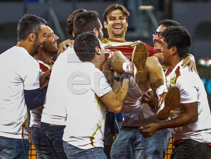Spanish David Ferrer (3-R) is tossed by his assistants during the tribute received after his Mutua Madrid Open's round of 32 game against German Alexander Zverev played at Caja Magica tennis complex, in Madrid, Spain, 08 May 2019. This has been the last match of Ferrer as a professional tennis player. EPA-EFE/JUANJO MARTIN