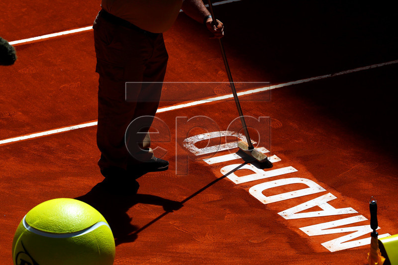 A worker prepares the court during the Mutua Madrid Open tennis tournament at the Caja Magica complex in Madrid, Spain, 09 May 2019. EPA-EFE/CHEMA MOYA