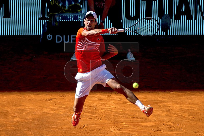 Novak Djokovic of Serbia in action against Dominic Thiem of Austria during their Mutua Madrid Open tennis semi final match at Caja Magica, in Madrid, Spain, 11 May 2019. EPA-EFE/Rodrigo Jimenez