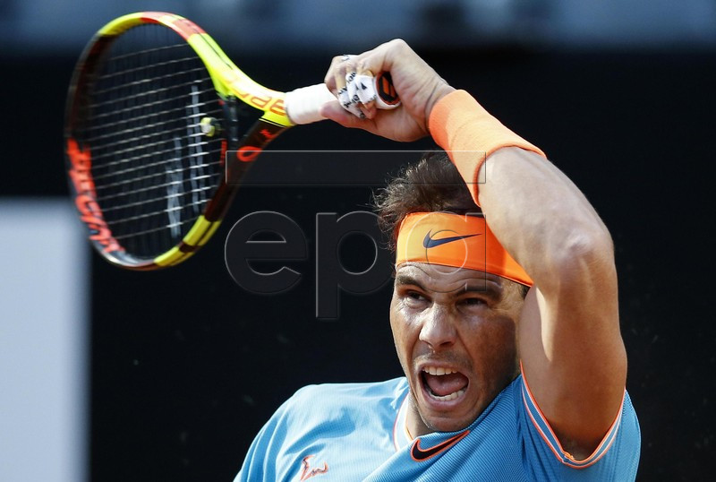 Rafael Nadal of Spain in action against Nikoloz Basilashvili of Georgia during their mens singles third round match at the Italian Open tennis tournament in Rome, Italy, 16 May 2019. EPA-EFE/RICCARDO ANTIMIANI