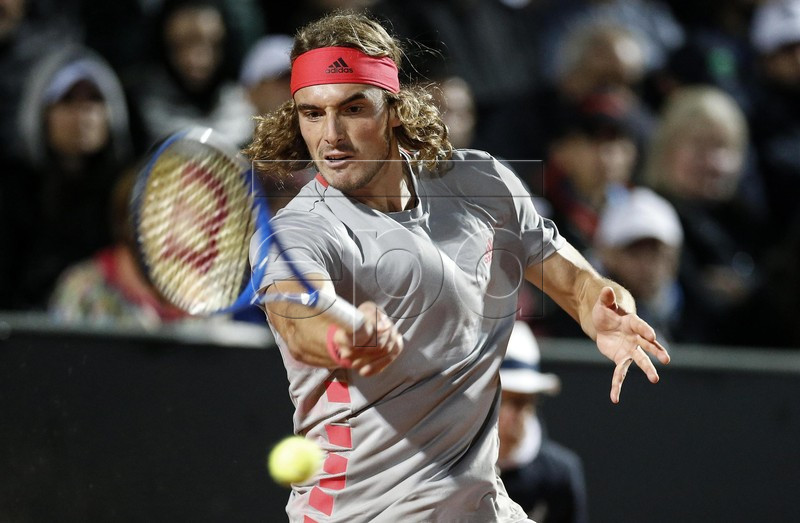 Stefanos Tsitsipas of Greece in action against Fabio Fognini of Italy during their mens singles third round match at the Italian Open tennis tournament in Rome, Italy, 16 May 2019. EPA-EFE/RICCARDO ANTIMIANI
