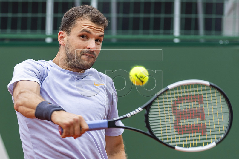 Grigor Dimitrov of Bulgaria in action against Marc-Andrea Huesler of Switzerland during their qualifying match at the Geneva Open tennis tournament in Geneva, Switzerland, 18 May 2019. EPA-EFE/MARTIAL TREZZINI