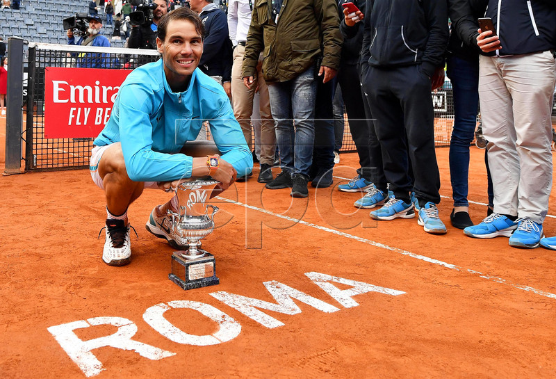 Rafael Nadal of Spain poses with his trophy after defeating Novak Djokovic of Serbia in their men's singles final match at the Italian Open tennis tournament in Rome, Italy, 19 May 2019. EPA-EFE/ETTORE FERRARI