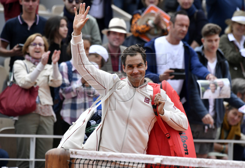 Roger Federer of Switzerland reacts after winning against Lorenzo Sonego of Italy during their men?s first round match during the French Open tennis tournament at Roland Garros in Paris, France, 26 May 2019. EPA-EFE/JULIEN DE ROSA