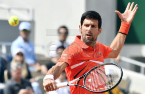 Novak Djokovic of Serbia plays Hubert Hurkacz of Poland during their men?s first round match during the French Open tennis tournament at Roland Garros in Paris, France, 27 May 2019. EPA-EFE/JULIEN DE ROSA