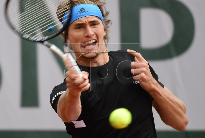 Alexander Zverev of Germany plays John Millman of Australia during their men?s first round match during the French Open tennis tournament at Roland Garros in Paris, France, 28 May 2019. EPA-EFE/CAROLINE BLUMBERG