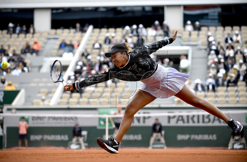 Naomi Osaka of Japan plays Anna Karolina Schmiedlova of Slovakia during their women?s first round match during the French Open tennis tournament at Roland Garros in Paris, France, 28 May 2019. EPA-EFE/JULIEN DE ROSA