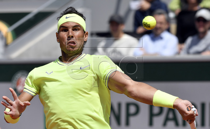 Rafael Nadal of Spain plays Yannick Maden of Germany during their men?s second round match during the French Open tennis tournament at Roland Garros in Paris, France, 29 May 2019. EPA-EFE/JULIEN DE ROSA
