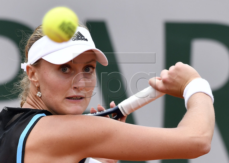 Kristina Mladenovic of France plays Petra Martic of Croatia during their women?s second round match during the French Open tennis tournament at Roland Garros in Paris, France, 29 May 2019. EPA-EFE/JULIEN DE ROSA