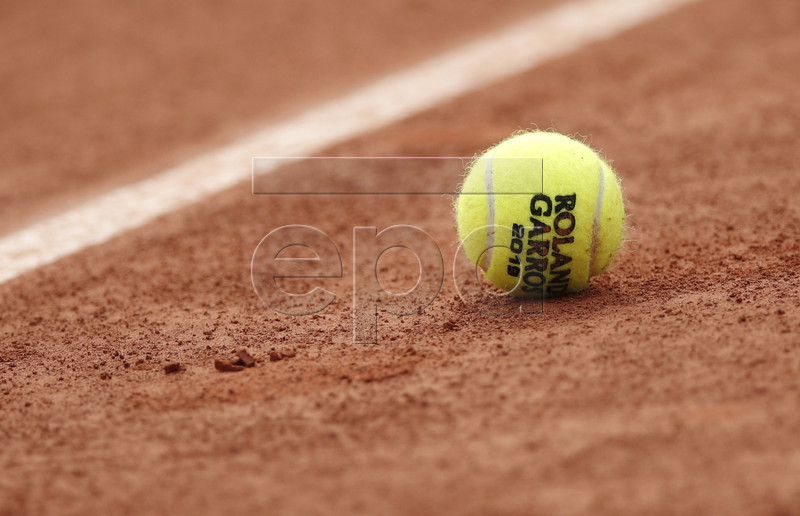 A tennis ball on the court during the French Open tennis tournament at Roland Garros in Paris, France, 29 May 2019. EPA-EFE/YOAN VALAT