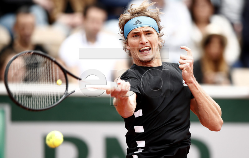 Alexander Zverev of Germany plays Mikael Ymer of Sweden during their men?s second round match during the French Open tennis tournament at Roland Garros in Paris, France, 30 May 2019. EPA-EFE/YOAN VALAT