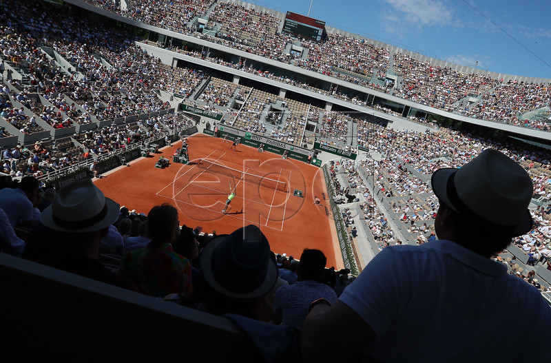 Spectators watch as Rafael Nadal of Spain plays Juan Ignacio Londero of Argentina during their men?s round of 16 match during the French Open tennis tournament at Roland Garros in Paris, France, 02 June 2019. EPA-EFE/SRDJAN SUKI