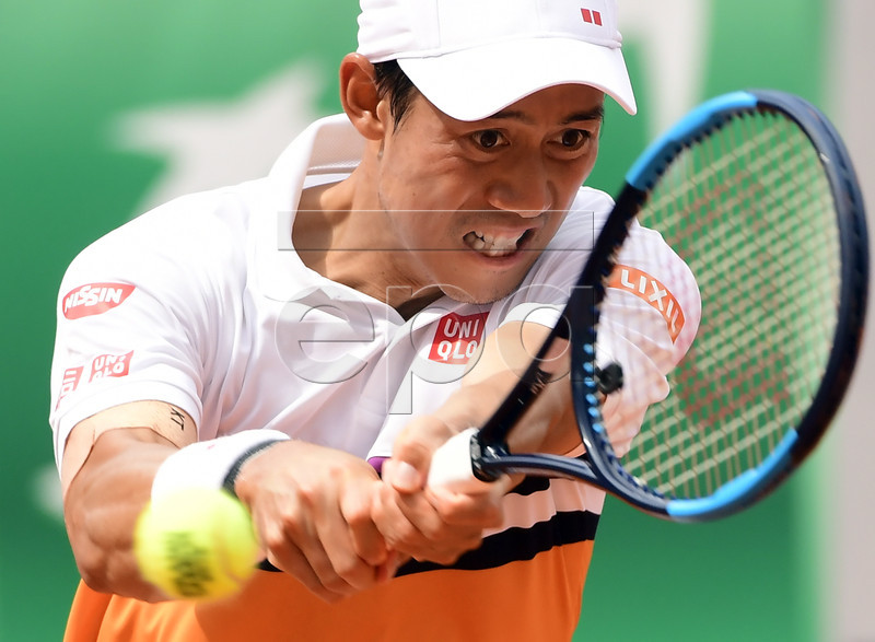 Kei Nishikori of Japan plays Rafael Nadal of Spain during their men?s quarter final match during the French Open tennis tournament at Roland Garros in Paris, France, 04 June 2019. EPA-EFE/CAROLINE BLUMBERG