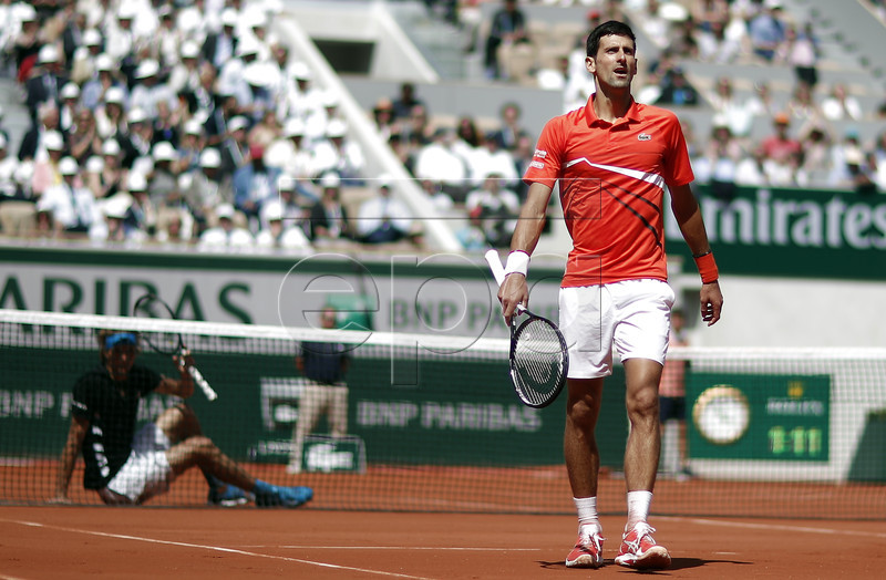 Novak Djokovic of Serbia reacts as he plays Alexander Zverev of Germany during their men?s quarter final match during the French Open tennis tournament at Roland Garros in Paris, France, 06 June 2019. EPA-EFE/YOAN VALAT