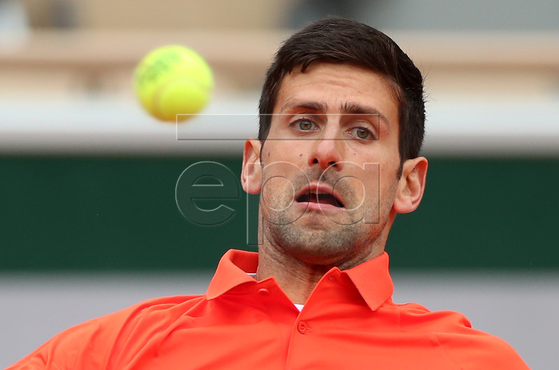 Novak Djokovic of Serbia plays Dominic Thiem of Austria during their men?s semi final match during the French Open tennis tournament at Roland Garros in Paris, France, 07 June 2019. EPA-EFE/SRDJAN SUKI