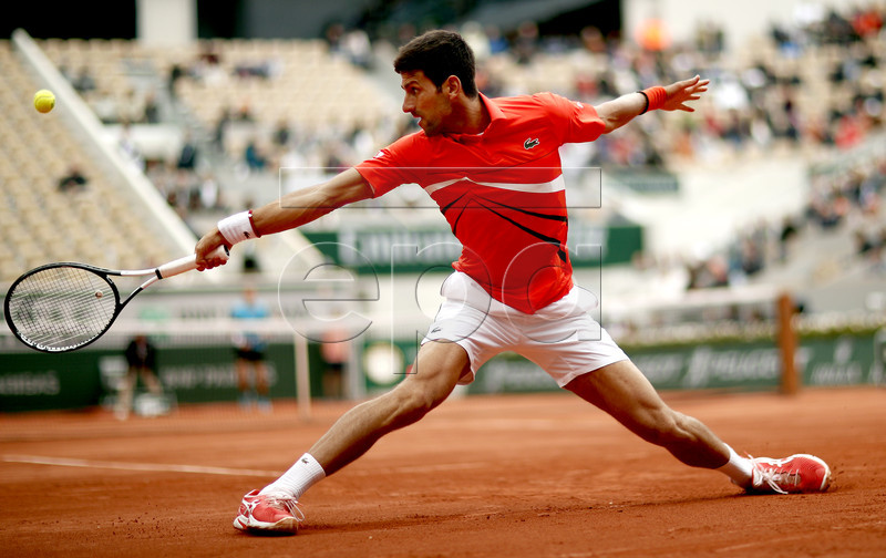 Novak Djokovic of Serbia plays Dominic Thiem of Austria during their men?s semi final match during the French Open tennis tournament at Roland Garros in Paris, France, 07 June 2019. EPA-EFE/YOAN VALAT
